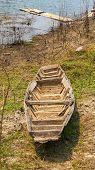 pic of old boat  - Old boat wooden brown in  the reservoir - JPG