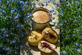 foto of forget me not  - coffe and the donuts on wood with forget - JPG