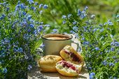 image of forget me not  - coffe and the donuts on wood with forget - JPG