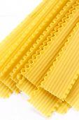 image of lasagna  - Photo of a bunch of fresh uncooked lasagna pasta - JPG