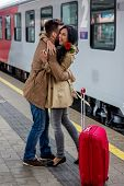 stock photo of long distance relationship  - parr on arrival or verabschiedeung on a platform at a station - JPG