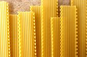 picture of lasagna  - Photo of a bunch of fresh uncooked lasagna pasta - JPG