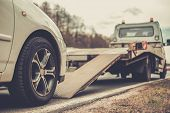 foto of accident emergency  - Loading broken car on a tow truck on a roadside  - JPG