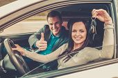 stock photo of seatbelt  - Happy driving student with a car keys - JPG