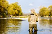 picture of woman boots  - woman fishing in the river in spring - JPG