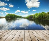 stock photo of board-walk  - forest lake and wooden board background - JPG