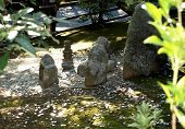 image of japanese coin  - Symbolic coins donation near ritual stones in buddhist temple - JPG