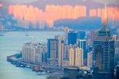 picture of tilt  - Tilt shift aerial view panorama of Hong Kong skyline and Victoria Harbor at sunset - JPG