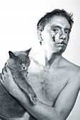 picture of silver-hair  - beautiful dark haired young man with silver makeup on his face and cat in hands - JPG