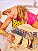 picture of pasta  - Child in hat making homemade pasta at kitchen - JPG