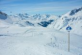 pic of apr  - View of the pistes ski trails and mountains of the Lech Zurs ski resort part of the Arlberg ski area from a mountainside restaurant - JPG