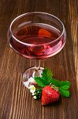foto of boose  - Red beverage with strawberry on wooden background - JPG