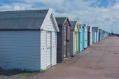 foto of beach hut  - Colorful beach huts by the seaside on a sunny day - JPG