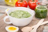 stock photo of pesto sauce  - sauce of pesto near a tomato olive oil and eggs in a studi - JPG