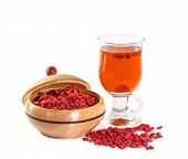 foto of infusion  - Glass healing infusion of goji berries and dried berries nearby - JPG
