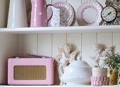 stock photo of shabby chic  - shot of a pretty dresser housing ornaments and tableware - JPG