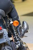 Постер, плакат: Zoom Motorcycle Taillight In Car Show Event