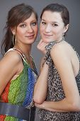 picture of friendship belt  - portrait of happy female friends over grey background - JPG