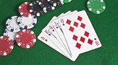 Royal Flush Of Diamonds And Poker Chips
