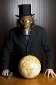 Man, gas mask, gun and earth globe