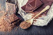 Постер, плакат: Chocolate Black chocolate A few cubes of black chocolate Chocolate slabs spilled from grated choc