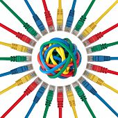 Ethernet Cable Plugs Pointing To A Ball Of Colored Cables