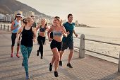 ������, ������: Group Of Athletes Running Along A Seaside Promenade