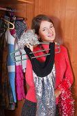 Girl Chooses Dress In Wardrobe