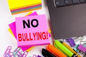 Writing Text Showing No Bullying Made In The Office With Surroundings Such As Laptop, Marker, Pen. B poster