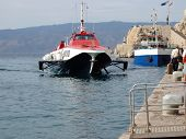 image of hydrofoil  - HIgh speed approaching the dock at the island of Hydra Greece