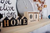 1 January Wooden Calendar With Home Sign. Happy Winter Holidays Concept. poster