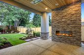 Outside Patio Boasts Gorgeous Stone Fireplace poster