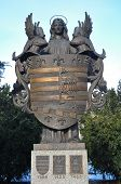 picture of armorial-bearings  - angel sculpture holding armorial bearing of city Kosice Slovakia - JPG