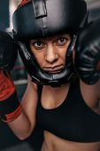 Female Boxer Geared Up For A Bout poster