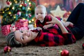 Happy Young Mother And Her Son Playing At Home During Christmas Holidays poster