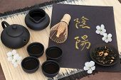 Chinese jasmine tea with yin and yang chinese calligraphy script, cherry blossom, teapot, cups, jug, poster