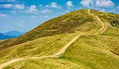 Footpath Through The Grassy Hills Of Mountains poster