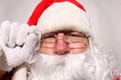 Santa Claus makes funny faces in a FISHEYE Lens. Funny Santa Claus Photos. poster