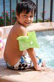 A Hispanic boy at the pool