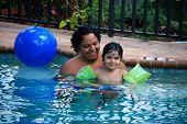 foto of floaties  - A four year old boy enjoys the pool - JPG