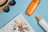 Sun Cream, Sun Hat, Cream, Sunscreen Bottle, Sun Cream, Lotion Bottle, Sunglasses Seashells On A Blu poster