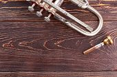 Old Trumpet On Wooden Background. Vintage Silver Trumpet And Copy Space. Brassy Trumpet Mouthpiece.  poster