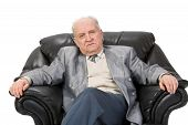 image of venereal disease  - Portrait of a senior man sitting in an armchair - JPG
