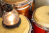 foto of congas  - Group of vintage conga drums with antique lantern - JPG