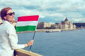 Happy Young Redhead Hungarian Urban Woman Holding Hungarian Flag At Budapest, Looking Away poster