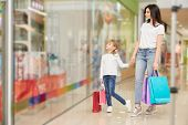 Family Shopping In Beautiful Shopping Center. Mother And Daughter Together Looking At Shop Window. Y poster
