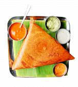 picture of urad  - Popular south indian breakfast dosa in golden brown color with 3 types of chutney and sambar - JPG