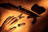 Crime Scene With Dead Woman Hand And Bloody Knife