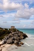 Cliffs With Mayan Ruins Above The Ocean At Tulum