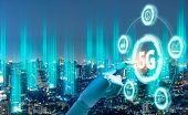 5g Network Digital Hologram And Internet Of Things On City Background.robot Android Hand Holding Ico poster